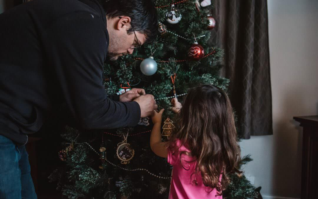 Father and daughter decoration their Christmas tree